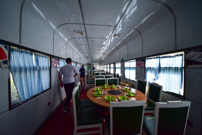 Train Hotel and Train Restaurant, full of strong ancients (old green train compartment)